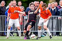DEN HAAG - HBS - MSC , Sportpark Craeyenhout , Voetbal , Promotie/degradatie topklasse , seizoen 2014/2105 , 28-05-2015 , HBS speler Berend Kaster (m) in duel met MSC speler Jeroen Kleene (r)