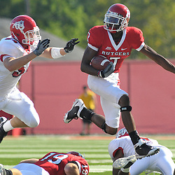 Sep 1, 2008; Piscataway, NJ, USA; Rutgers wide receiver Tiquan Underwood (7) leaps over and evades defenders during a catch and run for a first down against Fresno State during the first quarter of Fresno State's 24-7 victory at Rutgers Stadium.