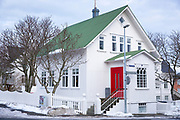 Traditional typical house with red front door on corner of Styrimannastigur and Oldugata  - in the old town area of capital city Reykjavik, Iceland
