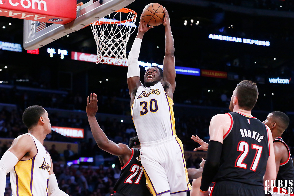 26 March 2016: Los Angeles Lakers forward Julius Randle (30) goes for the dunk on Portland Trail Blazers forward Noah Vonleh (21) during the Portland Trail Blazers 97-81 victory over the Los Angeles Lakers, at the Staples Center, Los Angeles, California, USA.