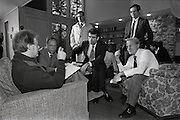 "(January 1977 – Plains, Georgia)  President-elect Jimmy Carter talks with several his closest transition team members at the Carter's family retreat ""Pond House"" just outside of the small south Georgia town of Plains. . Left to right are:  Michael Blumenthal, (Treasury Secretary nominee),  Stuart Eizenstat, (Chief Domestic Policy Advisor), Jack Watson, (Transition Director and later Chief of Staff),  Unidentified (dark hair, glasses, standing), Charles Schultze, (Chairman of the Council of Economic Advisors)."