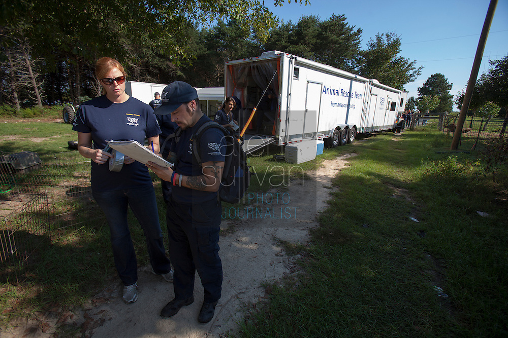 Kim Kelly (left), South Carolina State Director at The Humane Society of the United States, and Adam Parascandola, HSUS Director of Animal Cruelty Respnse, beging a map of the property during a raid on a puppy mill in Johnston, SC on Tuesday, Sept. 11, 2012. HSUS workers found over 200 dogs, nine horses and 30-40 fowl.