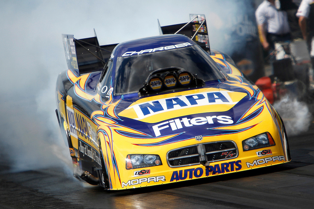 NHRA Funny Car driver Ron Capps does a burnout prior to a run at the 2010 NHRA Gatornationals held at Gainesville Raceway, Gainesville, FL.
