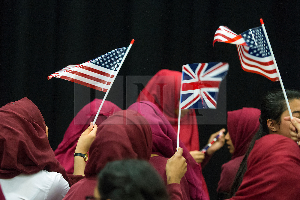 © Licensed to London News Pictures. 16/06/2015. London, UK. Students waving American and British flags during a visit by Michelle Obama to Mulbery School For Girls in east London. Photo credit: Ben Cawthra/LNP