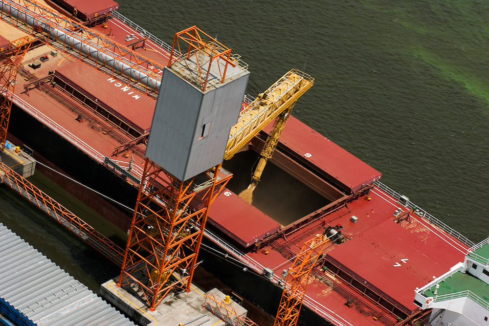 February 22nd 2006. Soybeans are loaded onto a cargo tanker at the controversial Cargill port on the Amazon River in Santarem, Para State, Brazil. ©Daniel Beltra