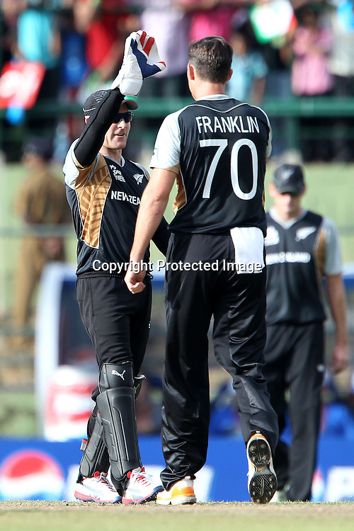 Brendon McCullum and James Franklin celebrte the wicket of Mohammad Hafeez during the ICC World Twenty20 Pool match between Pakistan and New Zealand held at the  Pallekele Stadium in Kandy, Sri Lanka on the 23rd September 2012<br /> <br /> Photo by Ron Gaunt/SPORTZPICS/PHOTOSPORT