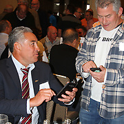 "Frank Bunce exchanges contact information with a fan at the official greeting luncheon.  NZ All Black former players Eric Rush, Frank Bunce, Charles Reichelmann, were honored guests among NZ and USA rugby fans at the pre-game ""Lost Afternoon Rugby Luncheon"" at the Chicago Hyatt Regency Hotel, Chicago, Illinois.  Photo by Barry Markowitz, 10/31/14, 2pm"