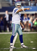 Dallas Cowboys quarterback Tony Romo (9) points as he calls a play in the shotgun formation in the first quarter during the NFL week 18 NFC Wild Card postseason football game against the Detroit Lions on Sunday, Jan. 4, 2015 in Arlington, Texas. The Cowboys won the game 24-20. ©Paul Anthony Spinelli
