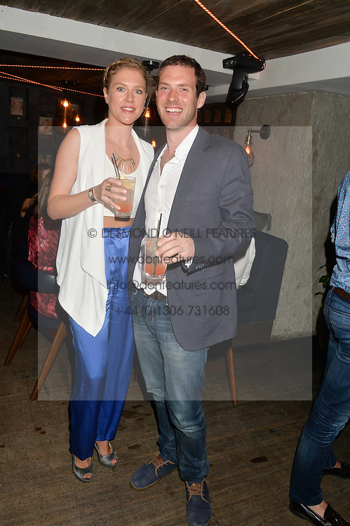 GENEVIEVE SCOTT and SAM KERSHAW at the launch of Geisha at Ramusake hosted by Piers Adam and Marc Burton at Ramusake, 92B Old Brompton Road, London on 11th June 2015.