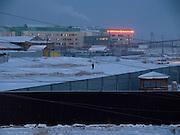Vor dem Sonnenaufgang in einem Aussenbezirk von Jakutsk. Jakutsk hat 236.000 Einwohner (2005) und ist Hauptstadt der Teilrepublik Sacha (auch Jakutien genannt) im F&ouml;derationskreis Russisch-Fernost und liegt am Fluss Lena. Jakutsk ist im Winter eine der k&auml;ltesten Gro&szlig;staedte weltweit mit durchschnittlichen Winter Temperaturen von -40.9 Grad Celsius. Die Stadt ist nicht weit entfernt von Oimjakon, dem K&auml;ltepol der bewohnten Gebiete der Erde.<br /> <br /> Before sunrise at the periphery of Yakutsk. Yakutsk is a city in the Russian Far East, located about 4 degrees (450 km) below the Arctic Circle. It is the capital of the Sakha (Yakutia) Republic (formerly the Yakut Autonomous Soviet Socialist Republic), Russia and a major port on the Lena River. Yakutsk is one of the coldest cities on earth, with winter temperatures averaging -40.9 degrees Celsius.