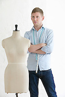 Tailor standing next to mannequin portrait