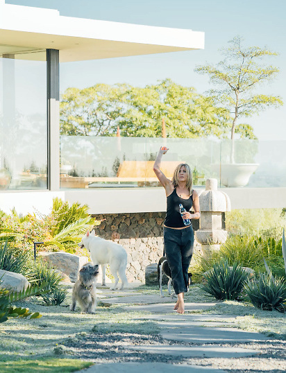 Jennifer Aniston has opened the doors on the sprawling Bel Air mansion she shares with husband Justin Theroux. The former Friends star, who married Theroux at the $15million mansion in a secret ceremony back in 2015, is seen in a variety of poses as part of a 'day-in-the-life-of' photoshoot for Smartwater. In one frame she gives her black and white pit bull Sophie a kiss while her other dog, a white shepherd mix called Dolly, looks on. Elsewhere in the shoot Jen, 48, is seen hanging out in her garden while playing with her pooches, then relaxing and getting ready for a night out on the town. The starlet looks incredible in the photographs, dressed casually in blue jeans, a white t-shirt and an oversized white cardigan. 07 Dec 2017 Pictured: Jennifer Aniston gives a glimpse inside her $15m Bel Air home for a Smartwater photoshoot. Photo credit: Smartwater/ MEGA TheMegaAgency.com +1 888 505 6342