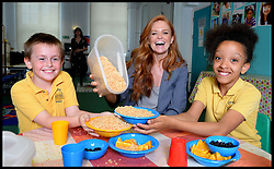 Eastenders actress Patsy Palmer serves breakfast to L to r Ryan Tappin 10, and Rehana Jardenier 10, on a visit to Laycock Primary School in Islington, London, to take part in London's Biggest Breakfast. Thursday, 22nd May 2014. Picture by Andrew Parsons / i-Images