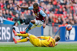Leandro Bacuna of Aston Villa is tackled by Alberto Moreno of Liverpool - Photo mandatory by-line: Rogan Thomson/JMP - 07966 386802 - 19/04/2015 - SPORT - FOOTBALL - London, England - Wembley Stadium - Aston Villa v Liverpool - FA Cup Semi Final.