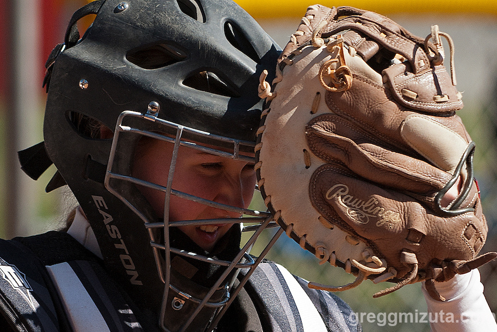 Vale's Bailey Gregory adjusts her catcher's mask during the Vale-Payette softball game, March 22, 2014 at Payette, Idaho. Gregory went three for five including a double as Vale won the game 7-3 to improve to 3-0 on the season.