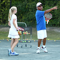 Omar Alcaino, Tupelo Junior Tennis Team Coach, wotks with Catherine Gillon during practice Thursday afternoon at the Tupelo Country Club. The team has advanced to the USTA Southern Sectionals.