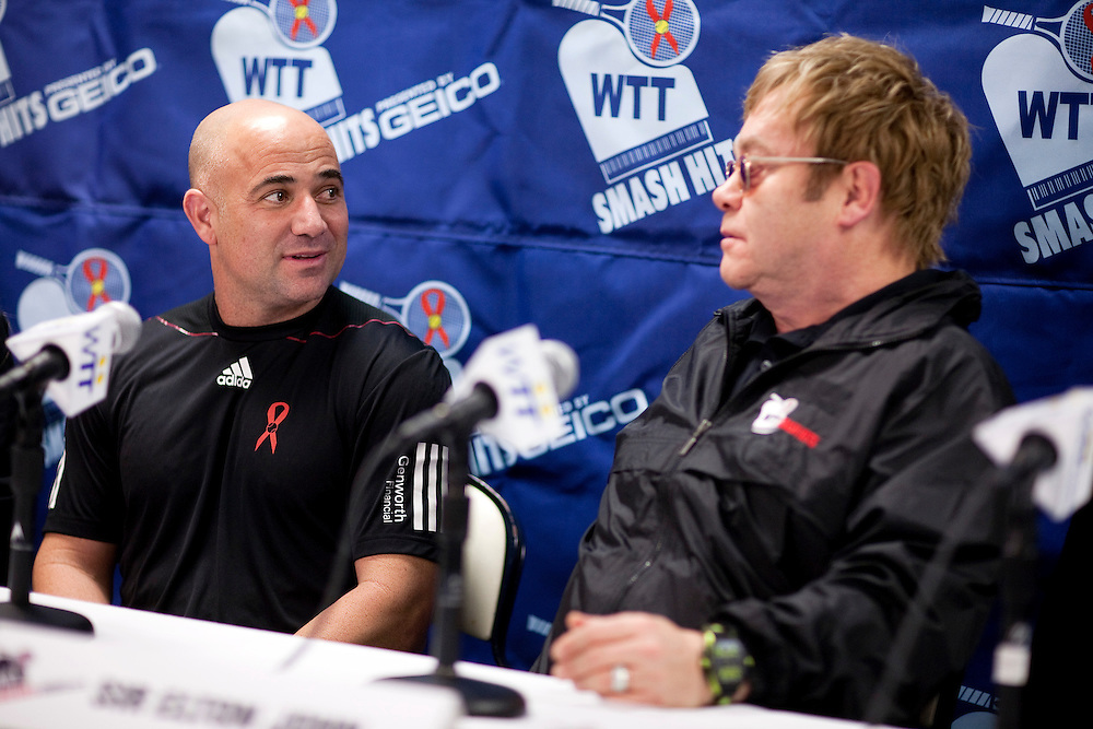 Andre Agassi and Sir Elton John speak at a press conference for the World Team Tennis Smash Hits fundraiser in Washington on November 15, 2010. The event is raising money for HIV/AIDS. REUTERS/Joshua Roberts    (UNITED STATES)