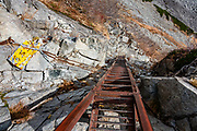 "Ladder on trail from Karasawa cirque to Kita-hotaka Hut. Karasawa cirque is cradled by the Hotaka Mountains, in the ""Northern Japan Alps"" (Hida Mountains) in Chubu-Sangaku National Park, Japan. Within the cirque, two lodges provide beds and meals for hikers and climbers: Karasawa Goya and Karasawa Hutte. Also known as Mount Hotaka or Hotaka-dake, the Hotaka Mountains reach 3190 meters elevation atop Mount Oku-Hotaka, Japan's third highest peak. About 2000 meters in diameter, the cirque bottoms out at 2300 m elevation. Snow melting here forms the River Azusa which flows through Kamikochi valley below."