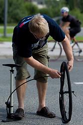 Reparing broken tire during cyclig Marathon Franja BTC City - Johan Museeuw Classic (156km), on June 12, 2011 in Ljubljana, Slovenia.  (Photo By Vid Ponikvar / Sportida.com)