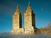 Reflection of the San Remo building towers in the icy water of The Lake in Central Park, Manhattan, 2007.