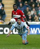 Photo: Chris Ratcliffe.<br />Coventry City v Middlesbrough. The FA Cup. 28/01/2006.<br />Ady Williams of Coventry beats Yakubu to the ball.