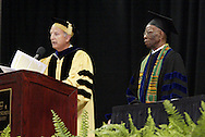 Dr. David Garrison (left) explains why Herbert Woodward Martin (right) is to become the 46th to receive an honorary degree as a Doctor of Humane Letters during the 43rd Semiannual Commencement at the Nutter Center, Saturday, June 12, 2010.  Beyond being 'the poet laureate of Dayton,' Garrison said that the now Dr. Martin has 'enthralled audiences all over the world with your presentations of [Paul Lawrence] Dunbar.'
