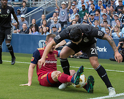 September 30, 2018 - Kansas City, Kansas, U.S - No foul is called on the grappling interference by Real Salt Lake midfielder Nick Besler #13 (below) against Sporting KC midfielder Felipe Gutierrez #21 (above) during the first half of the game. (Credit Image: © Serena S.Y. Hsu/ZUMA Wire)