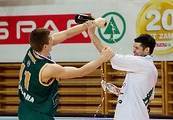 Dino Muric and MVP player Saso Ozbolt of Union Olimpija celebrate with a champign  after winning the basketball match between KK Helios Domzale and KK Union Olimpija in Final of Spar Slovenian Cup, on February 13, 2011 in Sportna dvorana Poden, Skofja Loka, Slovenia. Union Olimpija defeated Helios 92-55 and become Slovenian Cup Champion. (Photo By Vid Ponikvar / Sportida.com)
