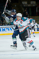 KELOWNA, CANADA -FEBRUARY 10: Madison Bowey #4 of the Kelowna Rockets checks a player of the Seattle Thunderbirds during second period on February 10, 2014 at Prospera Place in Kelowna, British Columbia, Canada.   (Photo by Marissa Baecker/Getty Images)  *** Local Caption *** Madison Bowey;