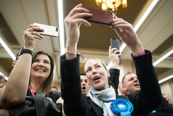 © Licensed to London News Pictures . 02/05/2019. Bolton, UK. Conservative Party supporters film the declaration . The count for Bolton Council at Bolton Town Hall . The Labour Party are threatened to lose their majority on the council . Local council elections are taking place across the country . Photo credit: Joel Goodman/LNP