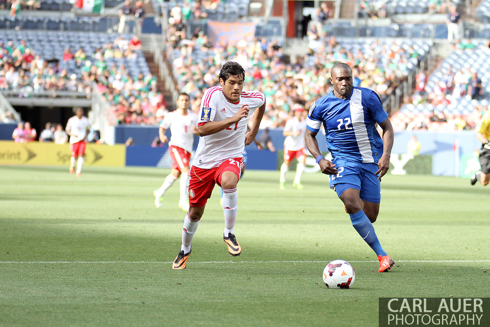 July 14 2013:  Mexico Forward Javier Orozco (21) and Martinique Defender Jean-Sylvain Babin (22) in the second half of action in the CONCACAF Gold Cup soccer match between Martinique and Mexico at Sports Authority Field in Denver, CO. USA.