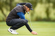 Tommy Fleetwood of England places the ball during the British Masters 2018 at Walton Heath Golf Course, Walton On the Hill, Surrey on 14 October 2018. Picture by Martin Cole.