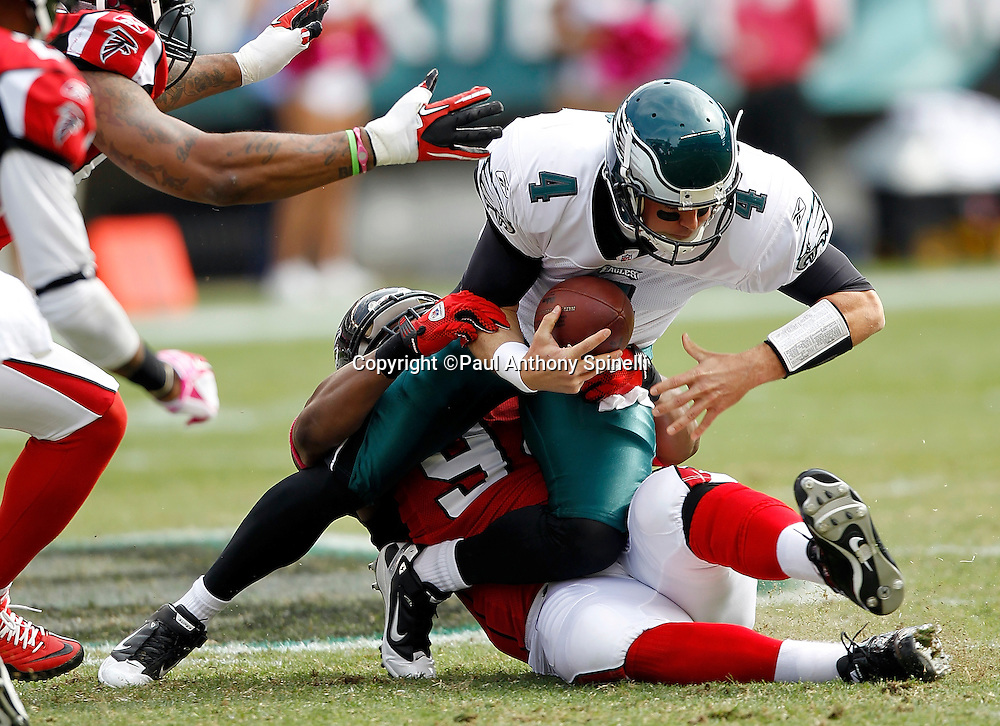 Philadelphia Eagles quarterback Kevin Kolb (4) gets sacked on third down by Atlanta Falcons defensive tackle Peria Jerry (94) during the first quarter of the NFL week 6 football game against the Atlanta Falcons on Sunday, October 17, 2010 in Philadelphia, Pennsylvania. The Eagles won the game 31-17. (©Paul Anthony Spinelli)