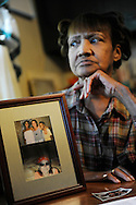 Sandy Drain pauses as she talks about the disappearance of her niece Gloria Walker, pictured in frame, at her home in Cleveland on Wednesday November 4, 2009. Walker has been missing since May 20, 2007...