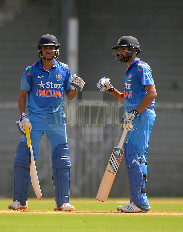 Rohit Sharma of India and Manish Pandey of India punch gloves during the practice match between India A and Sri Lanka held at the CCI Stadium, Mumbai,  India on the 30th October 2014<br /> <br /> Photo by:  Pal Pillai/ Sportzpics/ BCCI