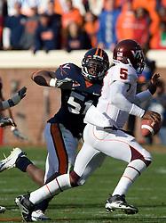 Virginia linebacker Clint Sintim (51) chases Virginia Tech quarterback Tyrod Taylor (5) out of the pocket.  The #8 ranked Virginia Tech Hokies defeated the #16 ranked Virginia Cavaliers 33-21 at Scott Stadium in Charlottesville, VA on November 24, 2007.