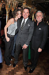 Left to right, JO MANOUKIAN, DAVID FURNISH and RAFFI MANOUKIAN at the 50th birthday party for Patrick Cox held at the Café Royal Hotel, 68 Regent Street, London on 15th March 2013.