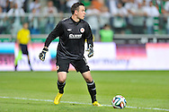 goalkeeper Brendan Clarke of St Patrick's controls the ball during Second qualifying round UEFA Champions League soccer match between Legia Warsaw and St. Patrick's Athletic at Pepsi Arena in Warsaw, Poland.<br /> <br /> Poland, Warsaw, July 16, 2014<br /> <br /> Picture also available in RAW (NEF) or TIFF format on special request.<br /> <br /> For editorial use only. Any commercial or promotional use requires permission.<br /> <br /> Mandatory credit:<br /> Photo by © Adam Nurkiewicz / Mediasport