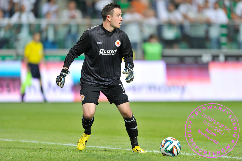 goalkeeper Brendan Clarke of St Patrick's controls the ball during Second qualifying round UEFA Champions League soccer match between Legia Warsaw and St. Patrick's Athletic at Pepsi Arena in Warsaw, Poland.<br /> <br /> Poland, Warsaw, July 16, 2014<br /> <br /> Picture also available in RAW (NEF) or TIFF format on special request.<br /> <br /> For editorial use only. Any commercial or promotional use requires permission.<br /> <br /> Mandatory credit:<br /> Photo by &copy; Adam Nurkiewicz / Mediasport