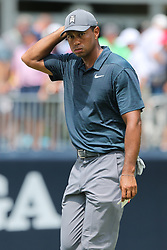 August 9, 2018 - St. Louis, Missouri, U.S. - TIGER WOODS reacts after putting the 9th green during the first round of the 100th PGA Championship at Bellerive Country Club. (Credit Image: © Debby Wong via ZUMA Wire)