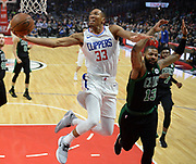 LA Clippers forward Wesley Johnson #33 gets past Boston Celtics forward Marcus Morris #13 for a layup in the first half. The Los Angeles Clippers played the Boston Celtics in a regular season NBA matchup in Los Angeles, CA 1/025/2018 (Photo by John McCoy, Los Angeles Daily News/SCNG)