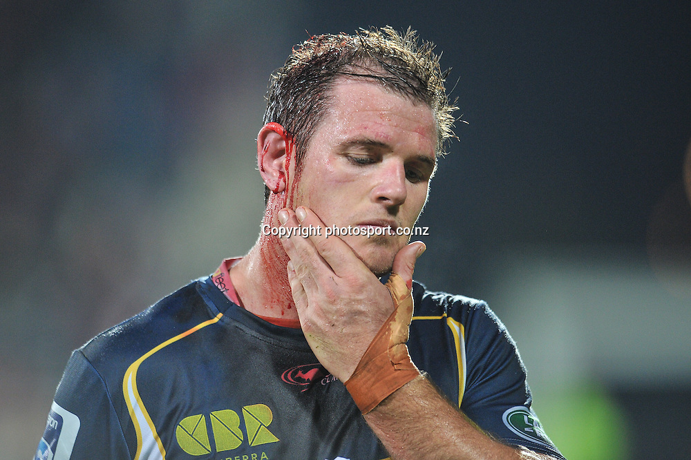 A wounded Tom McVerry of the Brumbies leaves the field in the Super Rugby game, Crusaders v Brumbies, at AMI Stadium, Christchurch, 3 May 2014. Photo:John Davidson/photosport.co.nz