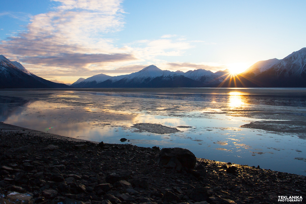 The sun rises over Southcentral Alaska's Turnagain Arm and surrounding mountains.
