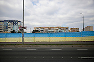 A fence in Kiev, Ukraine, is painted in the country's patriotic colors. Symbols of patriotism have been put around the city since the Maidan Revolution last winter. (Photo by Jeremy Hogan)