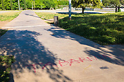 Tabernia -  right wing graffiti in Sant Cugat del Valles, Catalonia, Spain - found near some swastika symbols drawn on the same piece of pavement.  Tabernia is a fictional region inside Catalonia, as a parody of the Catalan movement and has been connected to the far right nationalist movement who are against Catalan independence.
