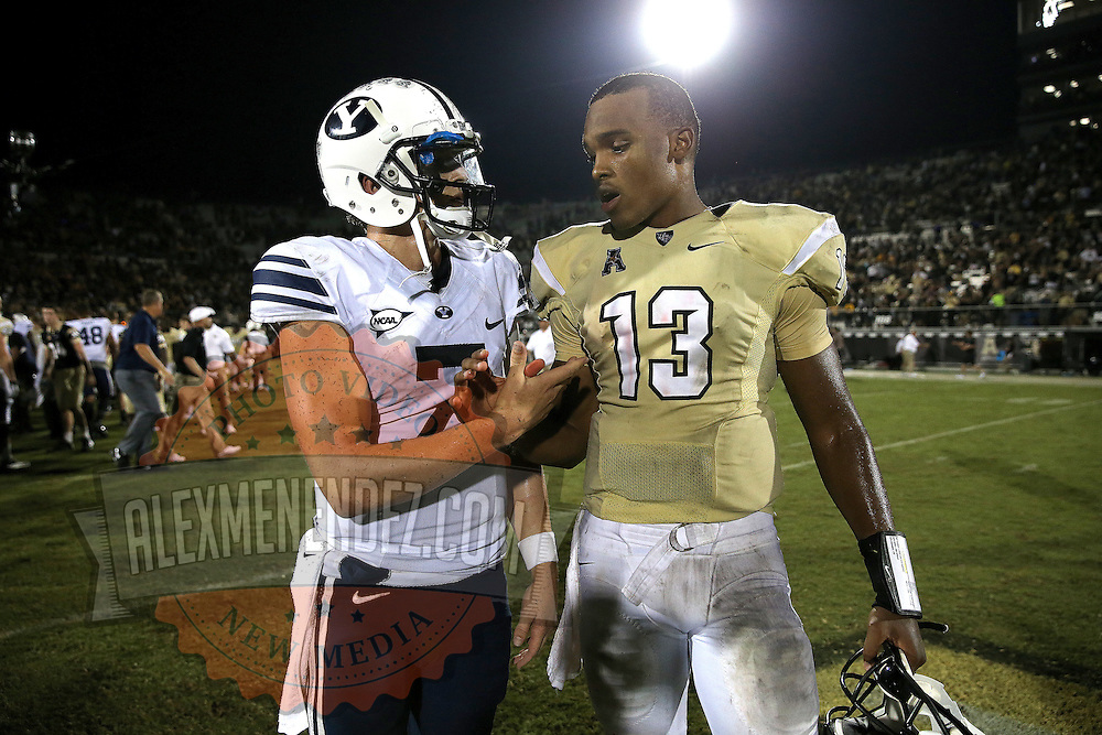 ORLANDO, FL - OCTOBER 09:  Quarterbacks Christian Stewart #7 of the Brigham Young Cougars (L) and Justin Holman #13 of the UCF Knights shake hands after UCF's 31-24 overtime win at Bright House Networks Stadium on October 9, 2014 in Orlando, Florida. (Photo by Alex Menendez/Getty Images) *** Local Caption *** Christian Stewart; Justin Holman