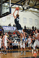 Petoskey Sophmore #34 Danny Kolp soars above the rim on a alley oop pass from Jason Bur