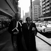 Anti apartheid campaigner Archbishop Desmond Tutu, rightm, laughs after delivering an anti-apartheid sermon in Johannesburg, 1985.  (Greg Marinovich)