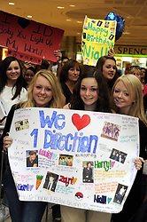 "© Licensed to London News Pictures. 15/09/2011.Lakeside,Essex, UK.One Direction at Lakeside,Essex to sign copies of their new book ""Dare to Dream"".  Liam, Harry, Zayn, Louis and Niall showed off the new book at   Lakeside's Central Atrium today (15.09.2011).Photo credit : Grant Falvey/LNP"