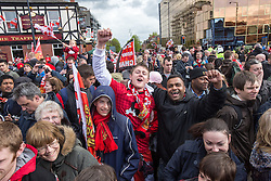 © Licensed to London News Pictures . 13/05/2013 . Manchester , UK . Fans lined Chester Road at the top of Sir Matt Busby Way . Manchester United trophy parade on Sir Matt Busby Way , from Old Trafford to Manchester City Centre this evening (Monday 13th May) . The team are celebrating their 20th league title win and commemorating the retirement of manager , Sir Alex Ferguson , by carrying the trophy on an opened top bus through the city . Photo credit : Joel Goodman/LNP